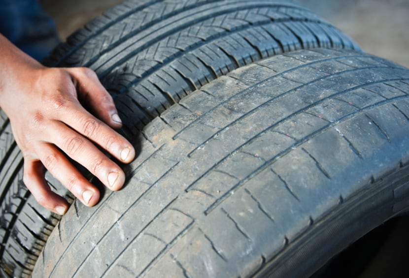 Part-worn tyre alongside new tyre
